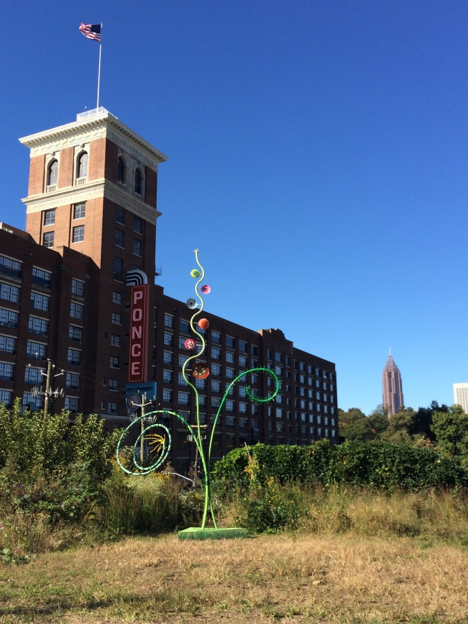 Since you'll be passing by, you can stop and check out the shops at Ponce City Market. Sculpture by Neil Carver.